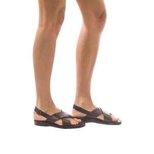 Model wearing Elan Buckle brown, handmade leather sandals with back strap - Front View