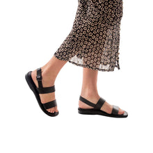 Load image into Gallery viewer, Model wearing Golan black, handmade leather sandals with back strap