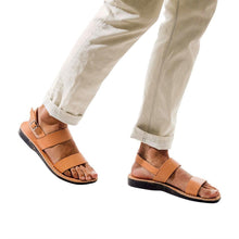 Load image into Gallery viewer, Model wearing Golan tan, handmade leather sandals with back strap