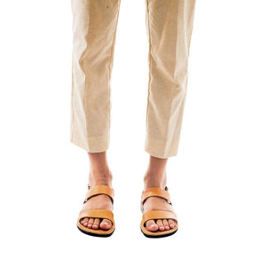 Model wearing Golan tan, handmade leather sandals with back strap