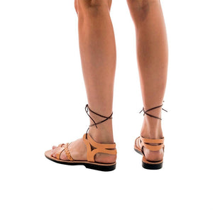 Model wearing Ramah Tan, handmade leather sandals with back strap and toe loop