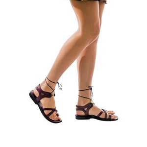 Model wearing Ramah violet, handmade leather sandals with back strap and toe loop