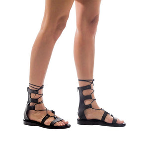 Model wearing Rebecca black, handmade leather sandals with back strap