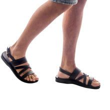 Load image into Gallery viewer, Model wearing Silas black, handmade leather sandals with back strap