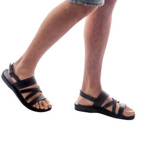Model wearing Silas black, handmade leather sandals with back strap