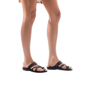 Model wearing The Good Shepherd brown, handmade leather slide sandals with toe loop