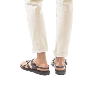 Model wearing The Good Shepherd Buckle brown, handmade leather sandals with back strap and toe loop