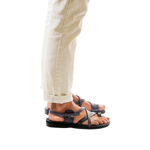 Model wearing The Good Shepherd Buckle gray, handmade leather sandals with back strap and toe loop
