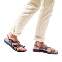 Load image into Gallery viewer, Model wearing The Good Shepherd Buckle gray, handmade leather sandals with back strap and toe loop