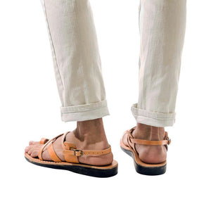Model wearing The Good Shepherd Buckle tan, handmade leather sandals with back strap and toe loop