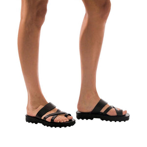 Model wearing The Good Shepherd Molded black, handmade leather slide sandals with toe loop