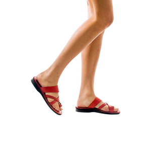 Model wearing The Good Shepherd red, handmade leather slide sandals with toe loop