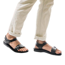 Load image into Gallery viewer, Model wearing The Original black, handmade leather sandals with back strap