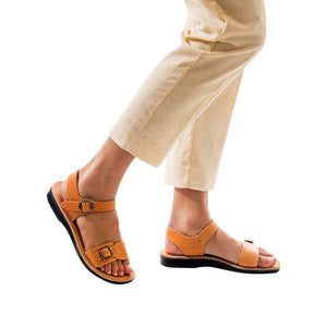 Model wearing The Original tan, handmade leather sandals with back strap
