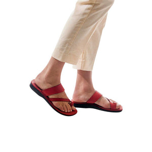 Model wearing Zohar red, handmade leather slide sandals with toe loop