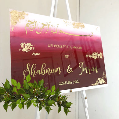 Welcome sign with additional text or gold leaf