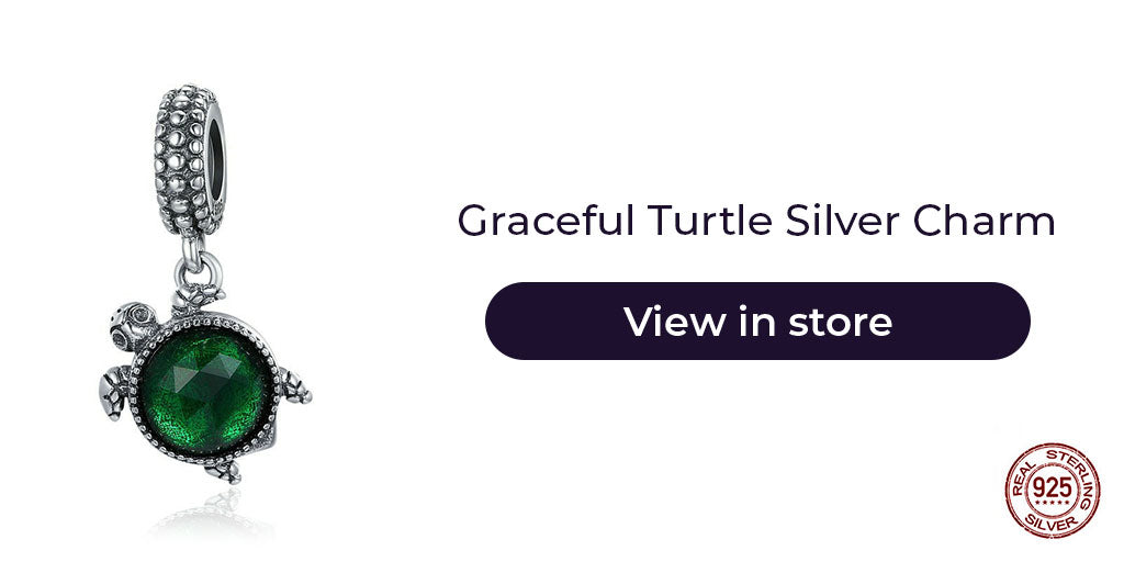 Gift guide for friends in 2019- Sterling silver sea turtle good luck charm with birthstone for charm bracelets and charm necklaces. Best personalized gift idea to make charm bracelets for women who you want to wish good luck in their endeavors.