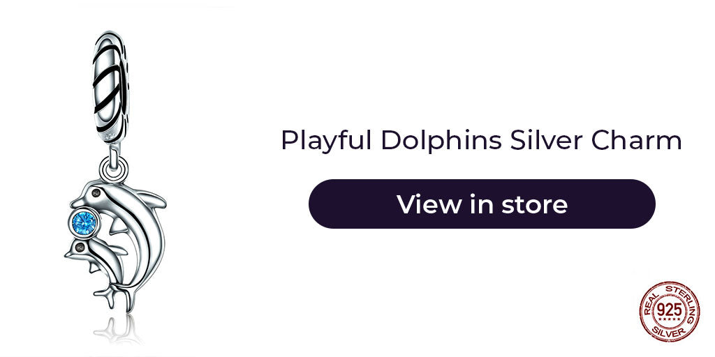 Gift guide for friends in 2019 - Sterling silver playful dolphins charm for charm bracelets and charm necklaces. Best personalized gift idea to make charm bracelets for women who loves sea creatures or simply is as cheerful as these dolphins.