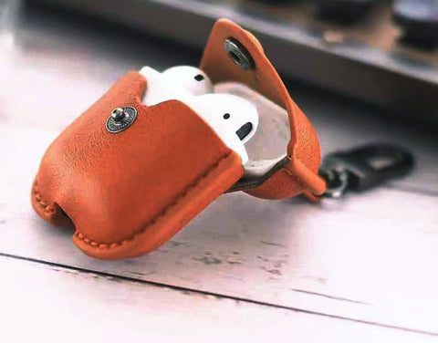 Muselot's Stylish AirPods case cover or protector to keep your AirPods readily available with a snap closure and toggle carabiner. Prevent losing of AirPods and makes a great fashion statement. This AirPod case protector is made with sturdy leather and rich colors to be used by both men and women.