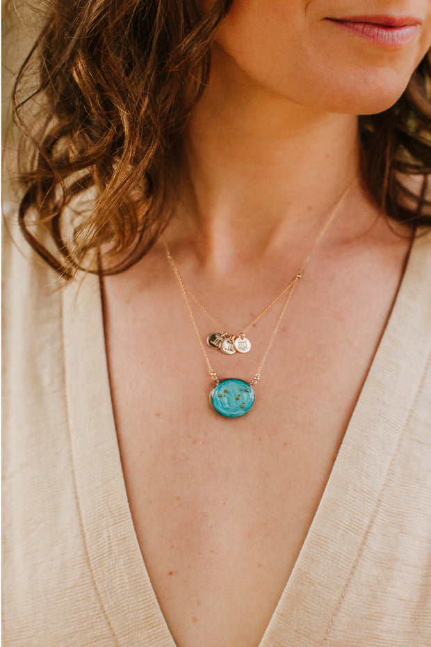 Mother's Necklace sky blue with three child charms in virgo and gemini on model