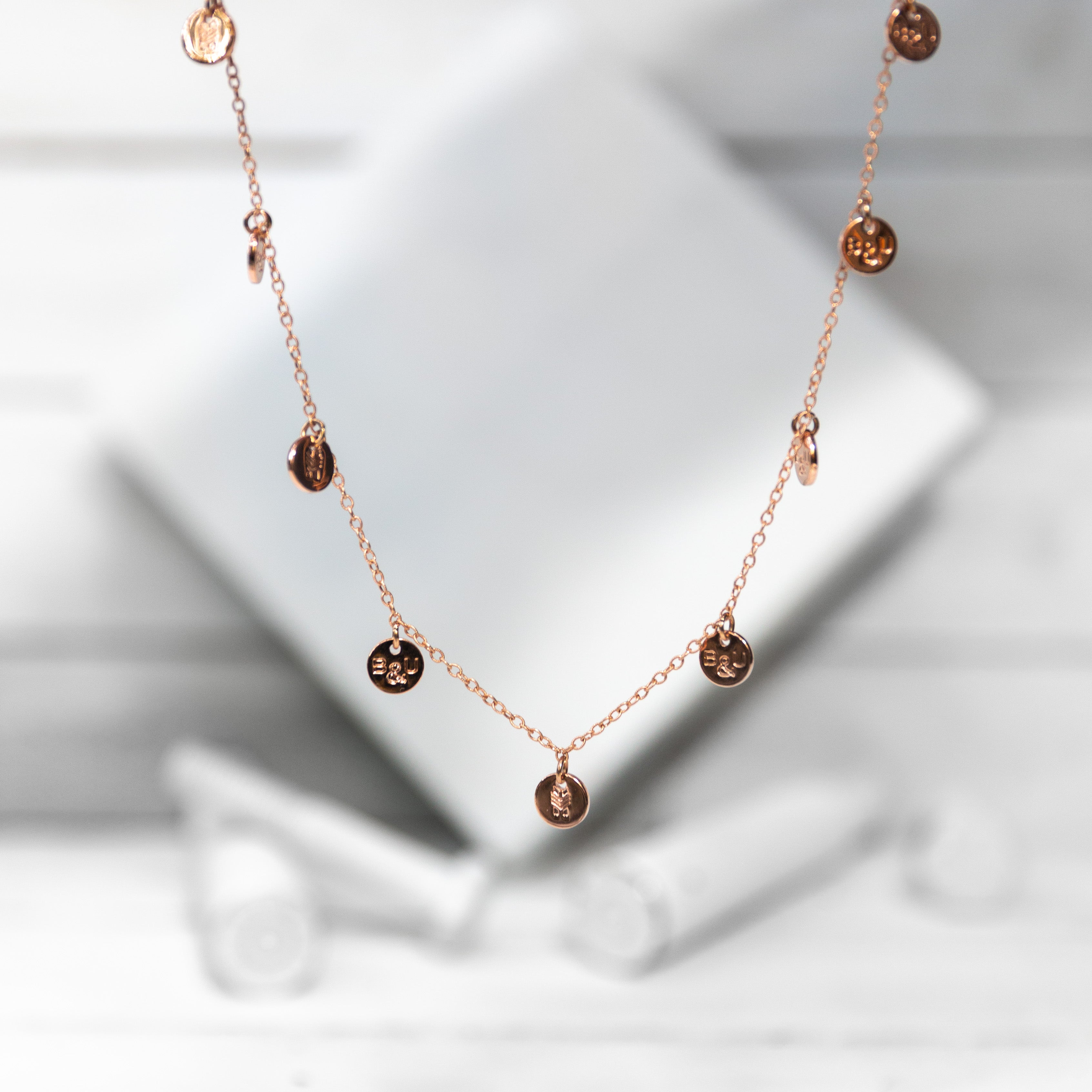 multi-charm / rose-gold necklace