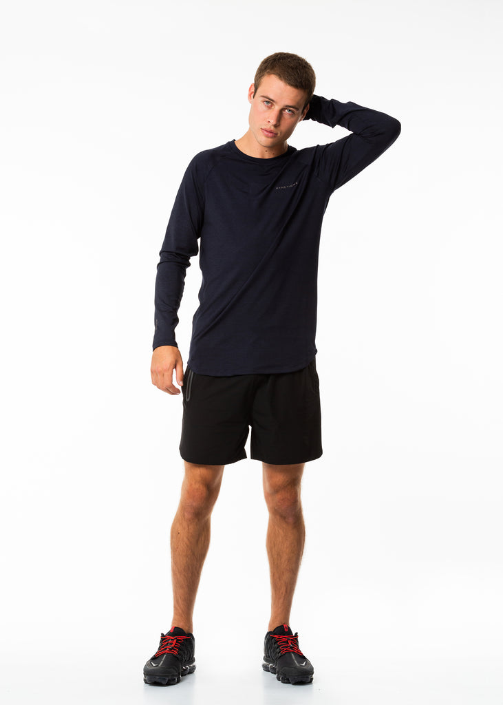 Men's sportswear online nz, long sleeve training top in dark blue, curved bottom hem with extra length, round neck, gyneitque logo on front