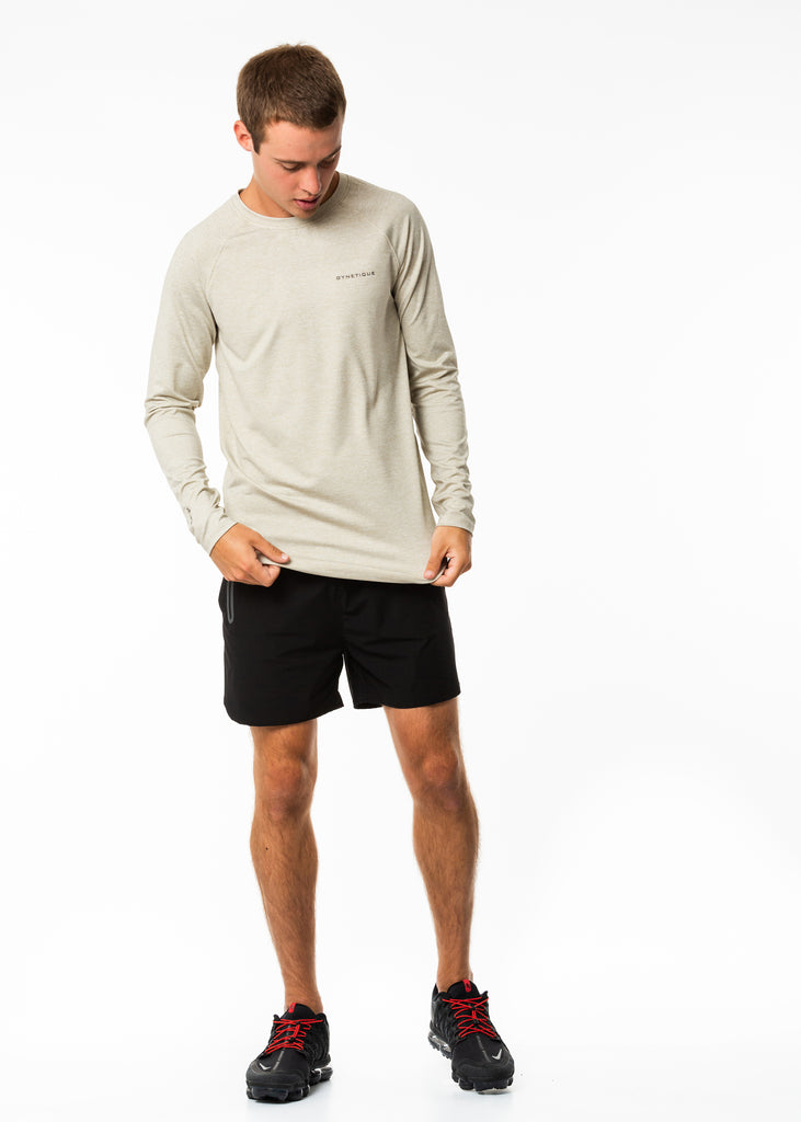 Men's workout clothes nz, oatmeal colour long sleeve training top, extra body length, fitted style, round neck, gynetique logo on chest