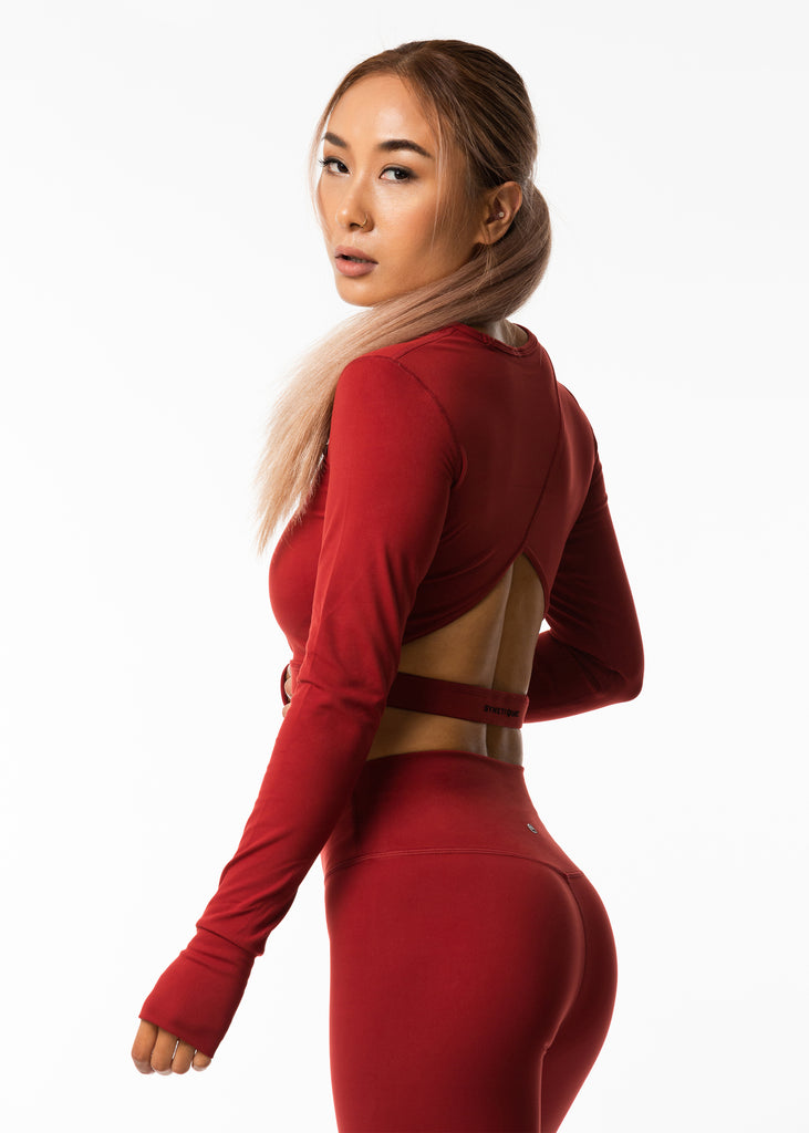 Popular red long sleeve gym crop top NZ, soft training base layer and leggings