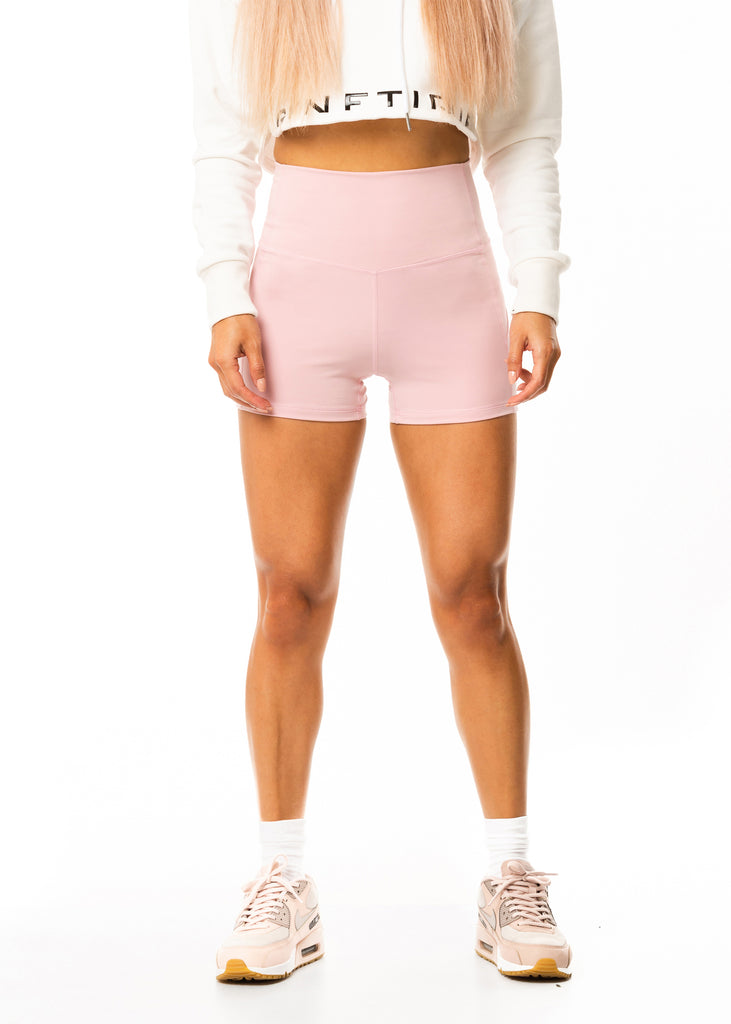 Best women' gym shorts online, tummy control panel, pastel pink stretchy nylon fitted style