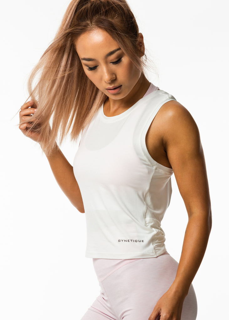 Women's workout clothes nz, white gym tank top, round neck, gynetique logo front, relaxed fit style