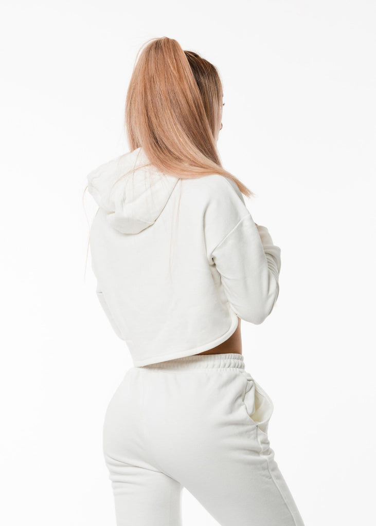 Women's fitness wear nz, white cropped hoodie, draw string hood, cropped length, relaxed fit