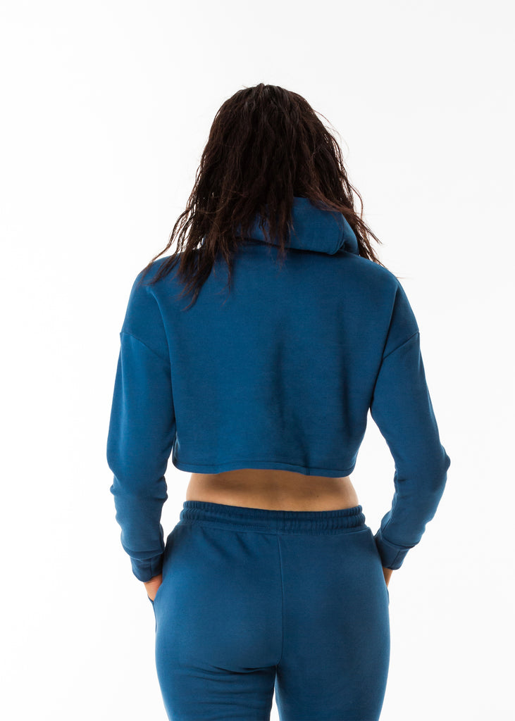 Streetwear online nz, Gynetique identity cropped hoodie in blue, long sleeves, brushed fleece fabric, dropped shoulder, ribbed cuffs, size small