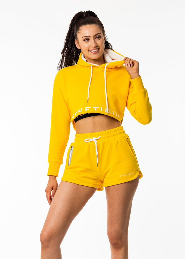 Women's activewear online, cropped hoodie in sunflower bright yellow, lined hood, white drawstring, gynetique logo front, full sleeve