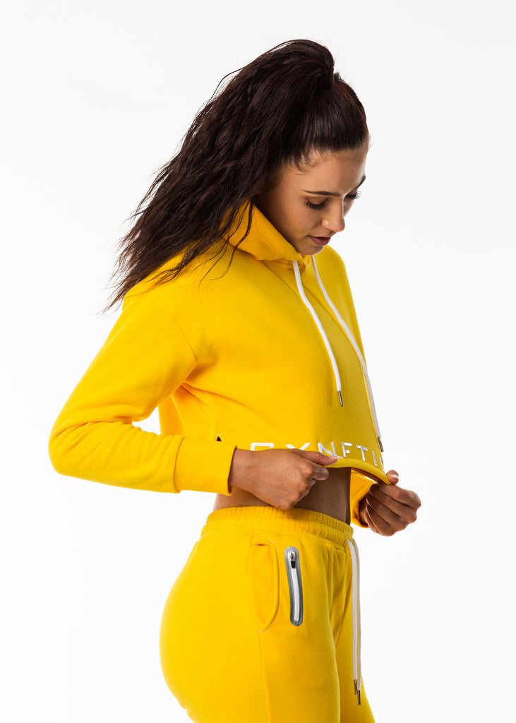 Women's sportswear New Zealand, bright sunflower yellow crop length hoodie, gynetique logo front, white drawstring, split side hem