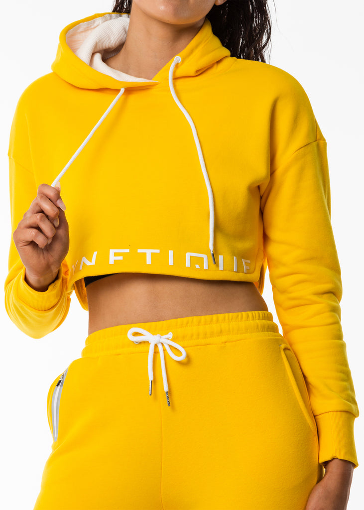 Women's street wear nz, yellow cropped hoodie, white drawstring, long sleeve, lined hood