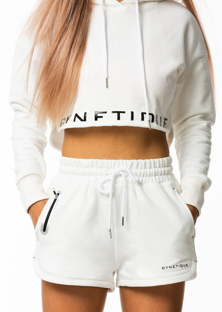 Women's casual clothing nz, white cropped hoodie with drawstring, Sie split hem, black gynetique logo, long sleeve