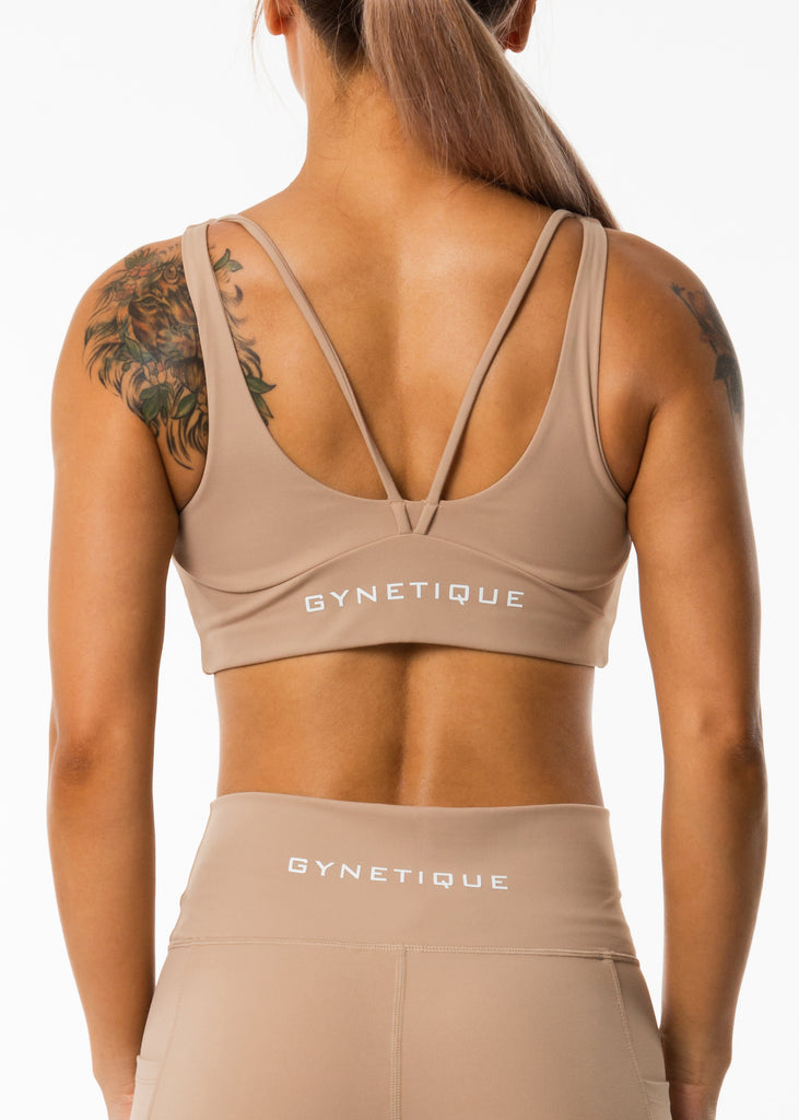 Women's sportswear online, Gynetique Intense collection beige padded sports bra, logo on back, two straps, round scoop neck, elastic waist band