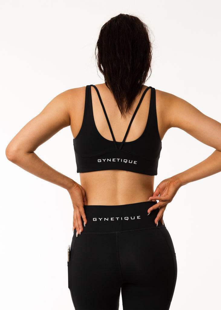 Women's gym wear brand nz, Gynetique Intense collection black sports bra, padded cups, two back straps, logo on back, elastic waist band