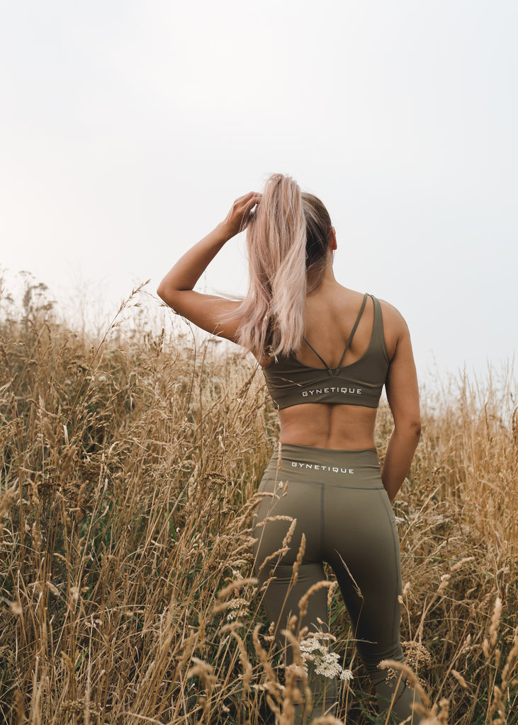 Women's squat proof tights and sports bra in khaki, Christchurch port hill background