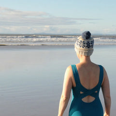 Sea swimmer wearing a Deakin and Blue sustainable swimwear and bobble hat