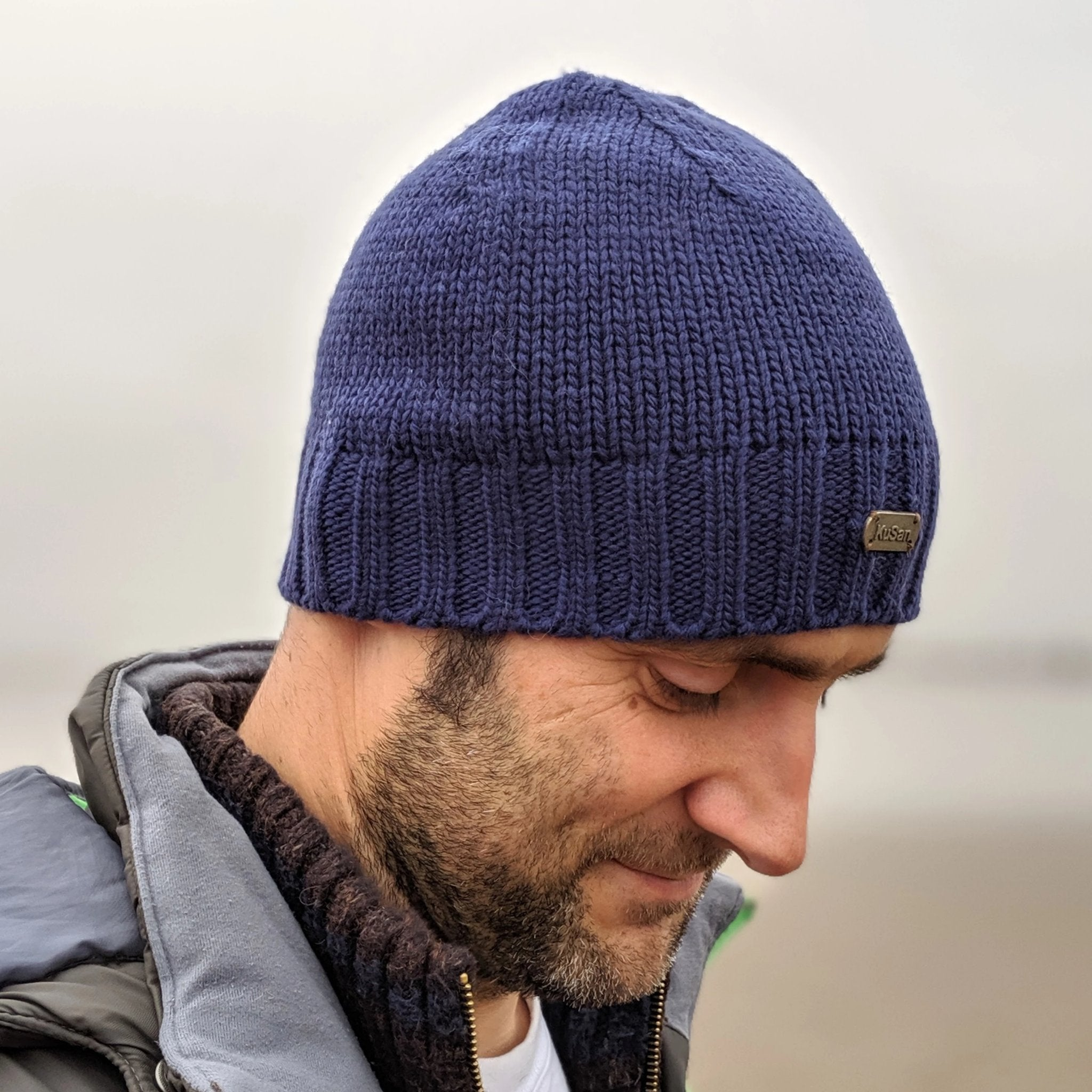 Man wearing blue merino wool beanie