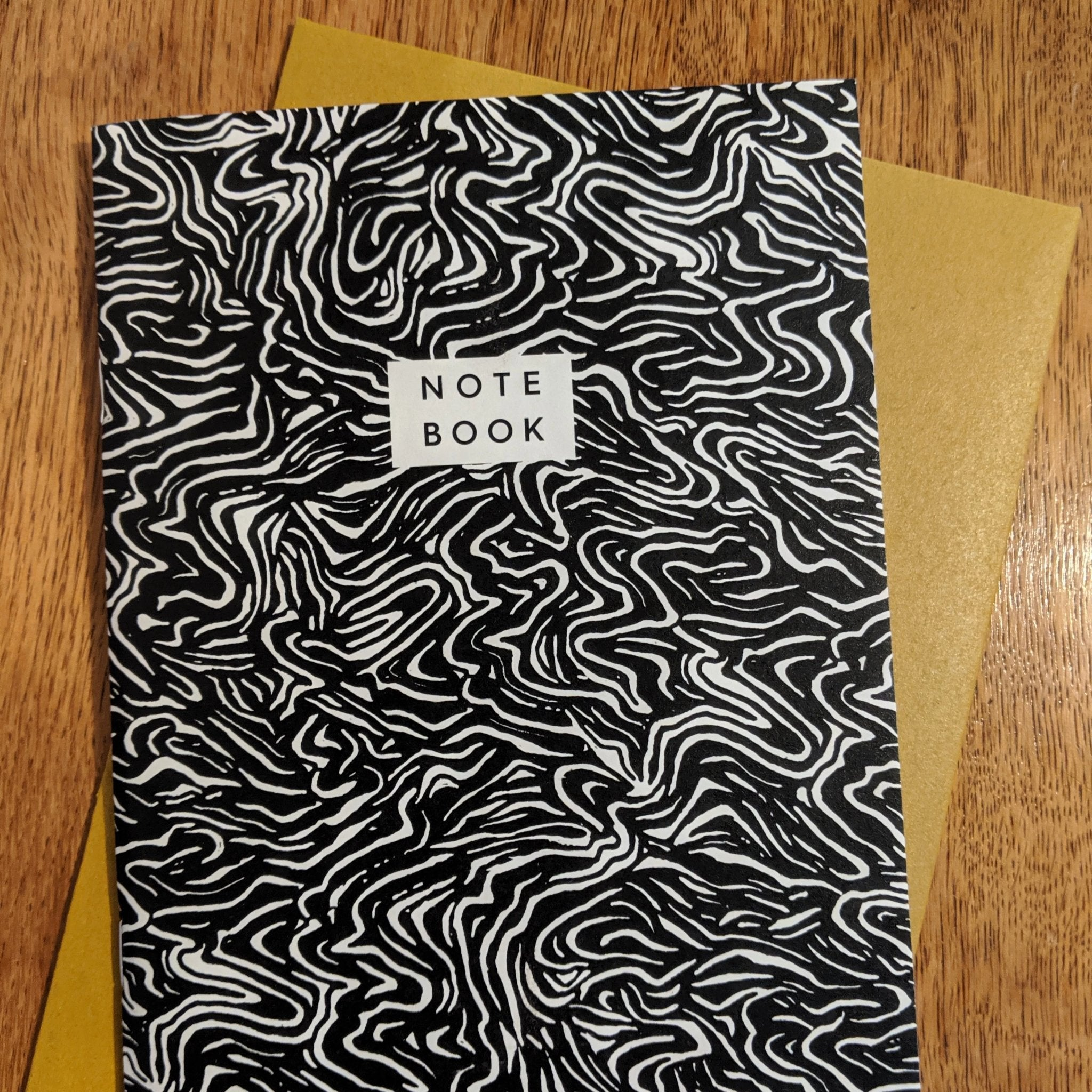 Recycled paper note book wave pattern