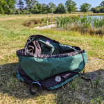 Swim Feral Turtleback bag for wild swimmers beside a lake