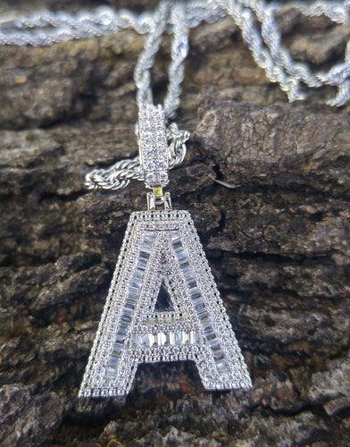 white gold baguette/ solitaire initial pendant with 20 in rope chain