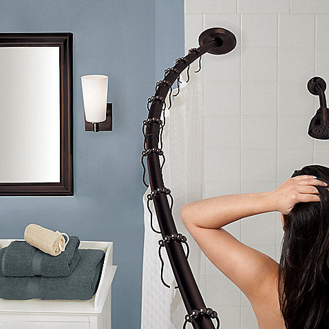 small blue bathroom with white shower, rubbed bronze curved shower rod for extra elbow room in the shower!... 5 Steps to Make Your Small Shower Look Bigger Without Remodeling from Bathroom Bliss by Rotator Rod