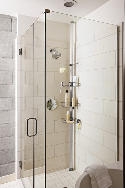small but clean shower with glass doors and tension rod shower caddy, large white subway tiles... 5 Steps to Make Your Small Shower Look Bigger Without Remodeling from Bathroom Bliss by Rotator Rod