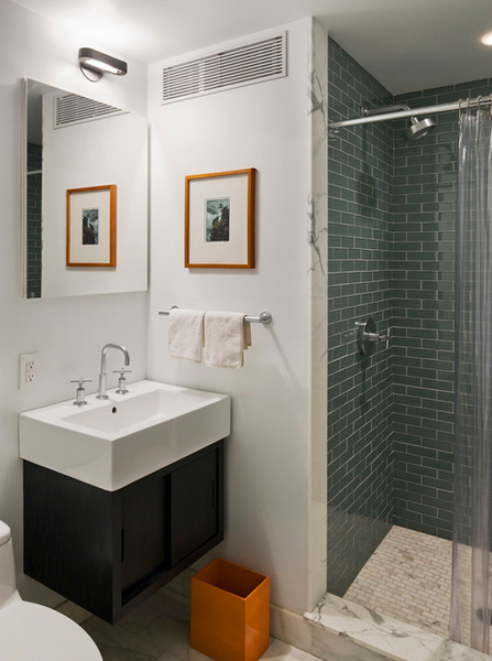 small white bathroom with small shower, blue-green subway tile with white grout; the transparent shower curtain makes the space look bigger... 5 Steps to Make Your Small Shower Look Bigger Without Remodeling from Bathroom Bliss by Rotator Rod