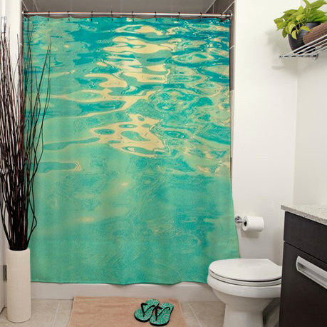 peaceful blue pool water shower curtain in white bathroom... 6 Perfect Beach Shower Curtains for Summer from Bathroom Bliss by Rotator Rod