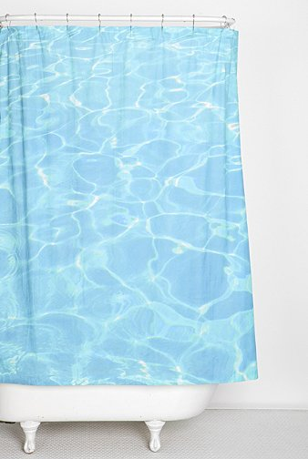 blue pool water shower curtain with white freestanding bathtub... 6 Perfect Beach Shower Curtains for Summer from Bathroom Bliss by Rotator Rod