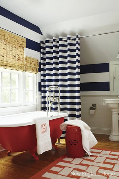 large bathroom with red claw foot tub, blue and white striped curtain and wall, white towels ... American Inspired Red, White & Blue Bathrooms from Bathroom Bliss by Rotator Rod